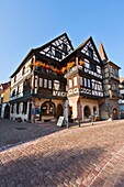 Alsace , architecture , blue , building , color image , day , Europe , France , Haut-Rhin , house , idyll , idyllic , Kaysersberg , outdoor , sky , vertical , V04-1585449 , AGEFOTOSTOCK