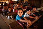 Closeup of children in a crowded schoolroom in La Per Her In Myanmar Burma, thousands of people have settled near the border as a result of oppression in their homeland Around 200 Burmese displaced people have settled in La Per Her, a village on the Burme