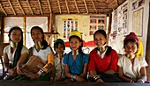 A group of Longneck girls pose in their school Approximately 300 Burmese refugees in Thailand are members of the indigenous group known as the Longnecks The largest of the three villages where the Longnecks live is called Nai Soi, located near Mae Hong So