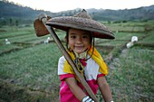 A young Longneck girl sits in a rice field Approximately 300 Burmese refugees in Thailand are members of the indigenous group known as the Longnecks The largest of the three villages where the Longnecks live is called Nai Soi, located near Mae Hong Son Ci