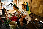 Longneck girls prepare food for a meal Approximately 300 Burmese refugees in Thailand are members of the indigenous group known as the Longnecks The largest of the three villages where the Longnecks live is called Nai Soi, located near Mae Hong Son City L
