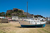 Gorey ST MARTIN JERSEY Boats in harbour houses seafront and Mont Orgueil Castle