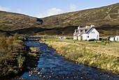 BALSPORRAN INVERNESSSHIRE White highland cottages in glen beside river
