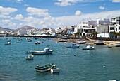 El Charco de San Gines ARRECIFE LANZAROTE Boats at anchor promenade and residential houses