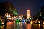 Mulong Pagoda also known as the Mulong Tower reflected in the Mulong Lake, Mulong Lake Park, Guilin, China