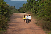 Teenagers on a motorbike in the Kampot province, Cambodia, Asia