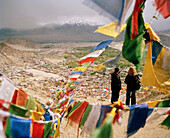 View through Buddhist prayer flags over capital Leh, Indus valley   Ladakh, Jammu and Kashmir, India