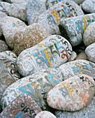 Om mani padme hung stones that got piled near the temple of Shey Palace by religious people, Ladakh, Jammu and Kashmir, India