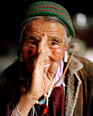 Countrywoman greeting Julee, 72 year old grandma of family Tsemopa, Ney near convent Thagchockling, Ladakh, Jammu and Kashmir, India