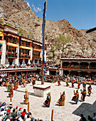 Dance of masks in the courtyard during the Hemis Gonpa Festival at convent Hemis, southeast of Leh, Ladakh, Jammu and Kashmir, India