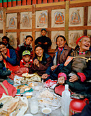 Families from villages close by having food in the courtyard, Hemis Festival at convent Hemis, southeast of Leh, Ladakh, Jammu and Kashmir, India