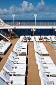 Lounge chairs on pool deck of cruise ship Azamara Journey, Azamara Club Cruises, Irish Sea, near Wales, United Kingdom