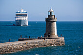 Lighthouse on jetty and cruise ship Azamara Journey, Azamara Club Cruises, at anchor, St Peter Port, Guernsey, Channel Islands, England, British Crown Dependencies