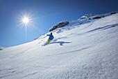 Skier downhill skiing, Montafon, Silvretta, Sankt Gallenkirch, Vorarlberg, Austria