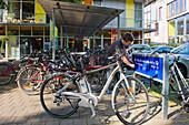 Electric bike at a charging station in the Vauban quarter, Freiburg im Breisgau, Black Forest, Baden-Wuerttemberg, Germany, Europe