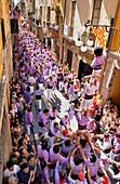 Colla Jove Xiquets de Tarragona ´Castellers´ human tower walking, a Catalan tradition Festa de Santa Tecla, city festival  Carrer Major Tarragona, Spain