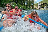 Jessica Florian, Jed Weber and Shannon Otto whitewater rafting the Cabarton section on the North Fork of the Payette River near the city of Cascade in central Idaho