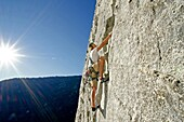Nic Houser rock climbing a route called Corrugation Corner which is rated 5,7 and located at Lovers Leap near Lake Tahoe in northern California