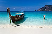 Long-Tail Boat and Woman on Ko Phi-Phi Island, Thailand