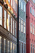 Windows reflecting the strong autumnal light in Gamla Stan - Stockholms Old Town - Stockholm, Sweden
