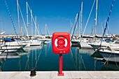 Life saing ring in front of Boats and yachts in Antibes Marina, Antibes, Cote d´Azure, France