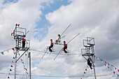 The Flying Wallendas perform on the tightrope at the Franklin County Fair, Greenfield, Massachusetts, United States