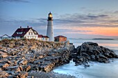 The Portland Head Light, built in 1791, protects mariners entering Casco Bay. The lighthouse is located in Fort Williams Park, Cape Elizabeth, Maine, USA