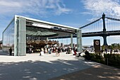 People visiting the newly restored historic Jane´s Carousel in Brooklyn Bridge Park in New York City, New York, USA