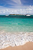 Boats moored off Orient Beach in St  Maarten, French West Indies