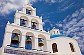 White bell tower of Greek Orthodox Church in Oia on the island of Santorini, the Cyclades Greece