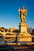 Early morning Angel on Ponte Sant Angelo with St  Peter´s Basilica beyond, Rome Lazio Italy