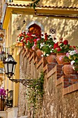 Flowers line a staircase to a home in Taormina, Messina Sicily Italy