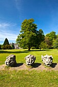England  Northumberland, Wallington Hall  Carved stone dragon heads in the gardens of Wallington Hall, a National Trust property located in the north of England