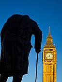 England, Greater London, City of Westminster  Churchill statue and the iconic Big Ben also known as the Clock Tower, part of the House of Parliament building also known as the Palace of Westminster, located in the City of Westminster, London