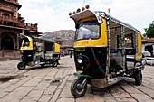 Typical tuc tuc auto rickshaw in Jodhpur bazaar, Rajasthan, India.