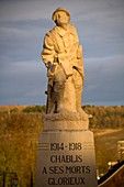 Sunset on the war memorial of the first and second world wars in Chablis, Yonne 89, in Burgundy