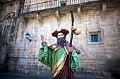 A mime dressed as St James the Apostle stands in the Obradoiro square of Santiago de Compostela, Spain. Hundred of thousands pilgrims walk every year to Santiago de Compostela using the French Way in the pilgrimage known as the Way of Saint James
