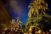 The Cristo de las Penas sculpture is carried in a throne in the orange court of the Mosque-Cathedral during an Easter Holy Week procession in Cordoba, Andalusia, Spain, April 17, 2011