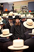 Amish men bid on farm equipment during the Annual Mud Sale to support the Fire Department in Gordonville, PA