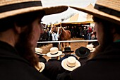Amish men at the horse auction during the Annual Mud Sale to support the Fire Department in Gordonville, PA