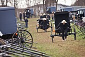 Amish men push a buggy home following the Annual Mud Sale to support the Fire Department in Gordonville, PA