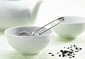 Bowl of green tea, infusion against white background