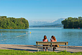 Bench on the bank of lake Sempachersee with Urner Alps, Sursee, Luzern, Switzerland, Europe