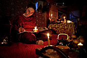 Lorelei Writing In Her Diary By Candlelight, She Left Everything Behind To Come Build And Live In Her Wood Cabin In The Creuse, France