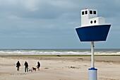 Europe, Belgium, North Sea, Western Flanders, Nieuwpoort, the beach, a miniature boat sailing on the North Sea