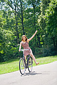 Pretty woman with bike in the park