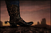 Cowboy boot and The Mittens at sunset, Monument Valley, Arizona, USA, America