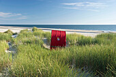 Red beachchair in the sand dunes, sandbank, near Nebel, Amrum, North Frisian Islands, Schleswig-Holstein, Germany
