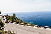 Trikes on winding coast road at Mediterranean Sea, Estellencs, Mallorca, Spain