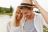 Young couple on the Isar riverbank, Munich, Bavaria, Germany
